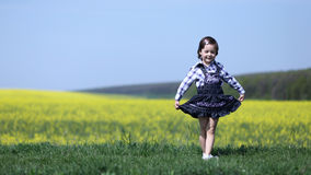 young-girl-curtsying-bowing-cute-child-bows-curtsy-dance-performance-grass-near-yellow-canola-field-37430387