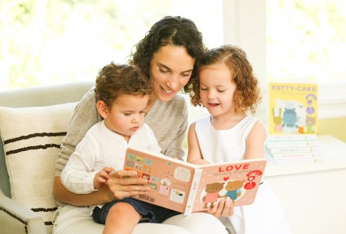 "Cali Meyrignac reading ""Love Nursery Rhymes"" to her two child.ren"