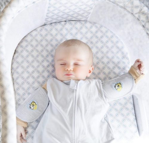 An infant using Swaddle Sleeves.