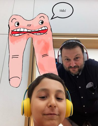 Mauro Moro with his son and co-author, Matteo Moro, and their illustration of Fingerman