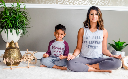 Tejal meditating with her son.