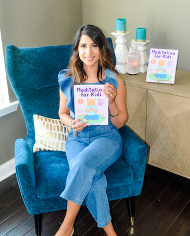 """Tejal with her book """"Meditation for Kids."""""""