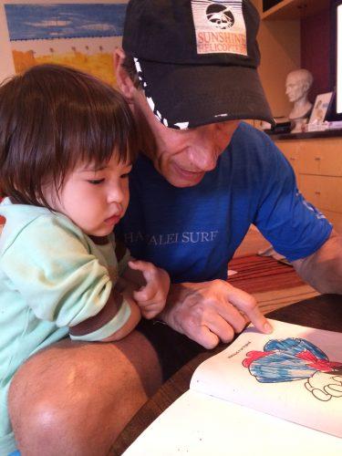 Michael Pellico reading to his niece, Sabrina.