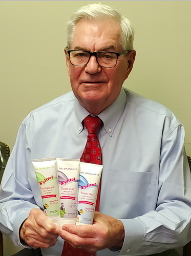 Dr. Branam with his Xylitol Toothpaste Products.