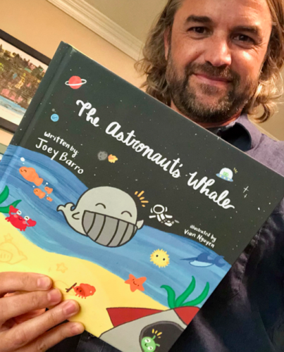 """Joey Barro with his book, """"The Astronaut's Whale."""""""