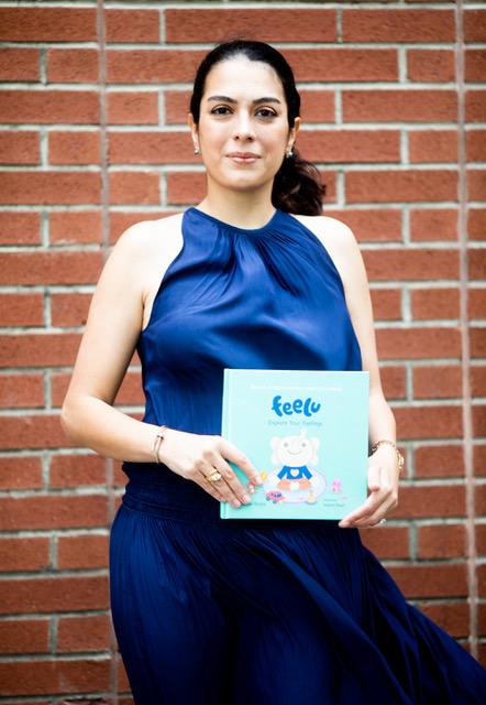 "Niloufar Shafiei with her award-winning book, ""Feelu: Explore Your Feelings."""